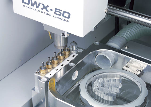 2011 Roland expands its dental mill line with the DWX-50, featuring 5-axis machining capability and an automatic tool changer for production of dental prosthetics.